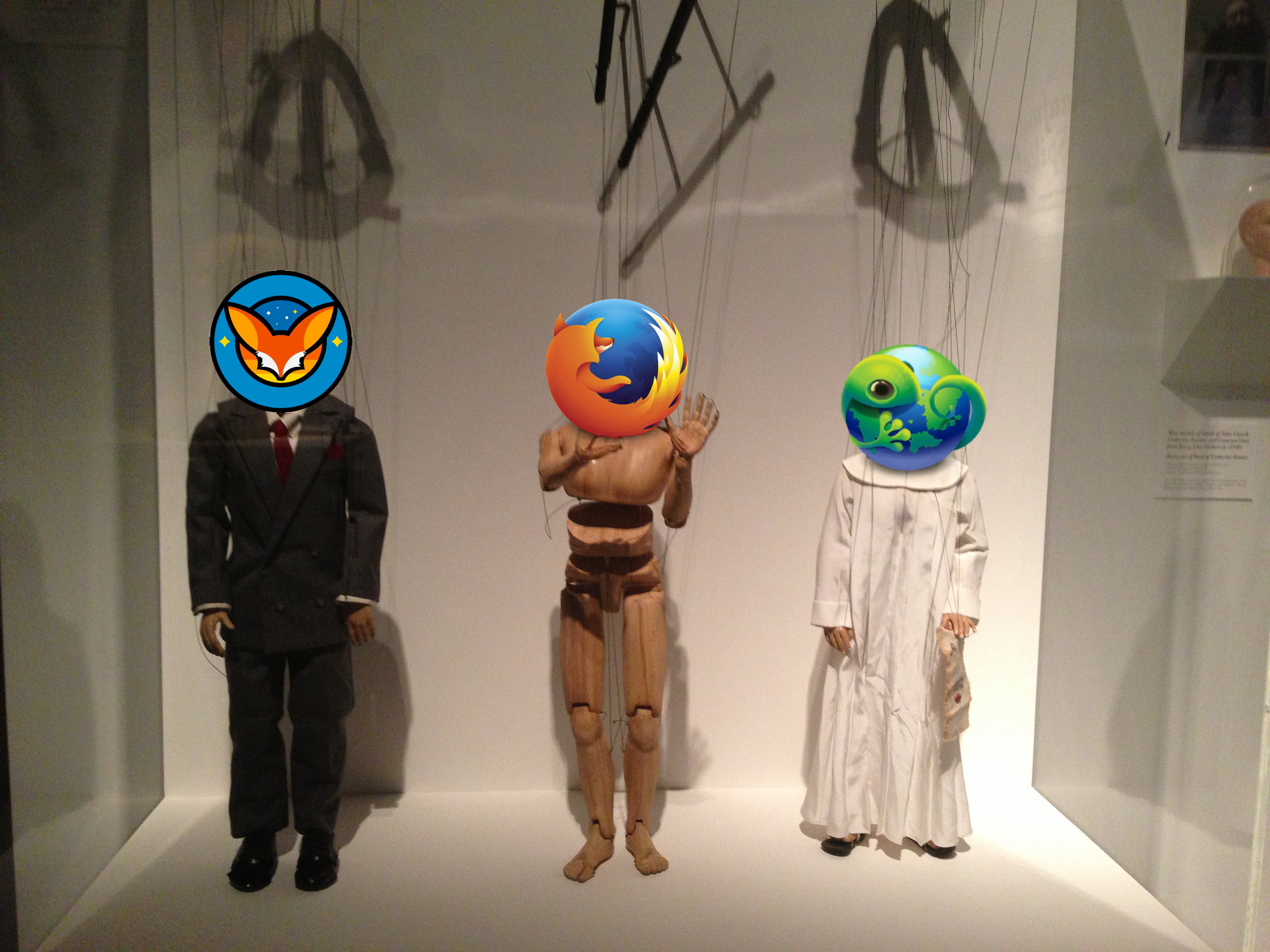 Picture of three marionette puppets with Fennec, Firefox, and B2G logos instead of heads